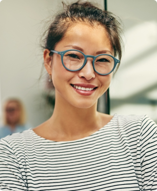 young-asian-businesswoman-smiling-confidently-in-a-4H6MSAK-small.jpg